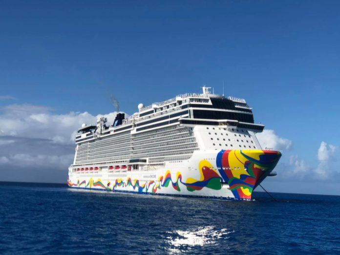 Norwegian cruise line ship at anchor